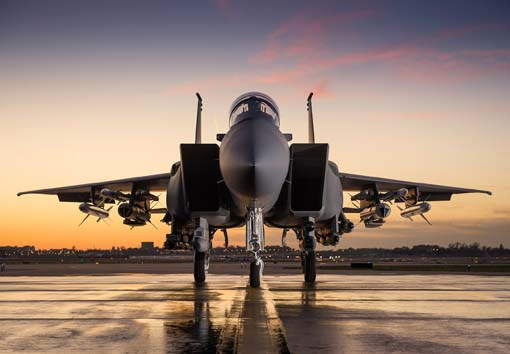 F-15 Aircraft #2 on Tarmac at Sunset with Weapons.